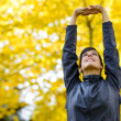 Arms up for stretching outside - Stockfoto