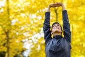 Arms up for stretching outside — Stock Photo