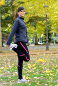 Woman stretching legs and warming up — Stock Photo