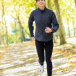 Woman running cheerful outside — Stockfoto