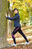 Stretching in autumn park — Stock Photo