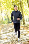 Woman running cheerful outside — Stock Photo