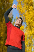 Male athlete celebrating victory — Stock Photo