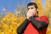 Athlete with cold — Stock Photo