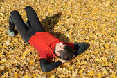 Athlete resting outdoors in autumn — Stock Photo