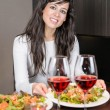 Woman serving dinner — Stock Photo
