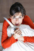 Frightened woman alone at home — Stock Photo