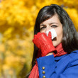Womwith flu and cold outdoors — Stock Photo #17490051