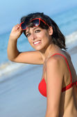 Happy pretty woman walking in beach at summer — Stock Photo