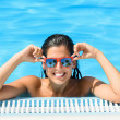Happy woman enjoying pool in tropical resort on summer — Stockfoto