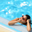 Enjoying summer relax in pool — Stock Photo
