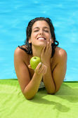 Woman summer diet at pool — Stock Photo