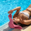 Happy woman relax at poolside — Stock Photo #19193695