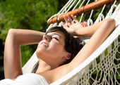 Woman napping in amaca outdoors on summer — Stock Photo