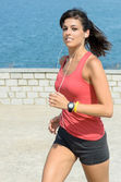 Fitness girl running on summer — Stock Photo