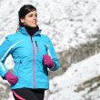 Woman athlete winter running — Stock Photo