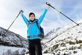 Happy woman winter mountain hiking — Stock Photo