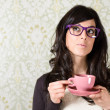 Woman thinking with cofffe cup — Stock Photo