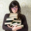 Upset woman with books — Stock Photo