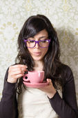 Vintage woman drinking steaming coffee — Stock Photo