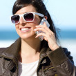 Woman with phone on beach — Stock Photo #22800132