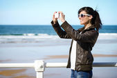 Woman on vacation taking photo — Stock Photo