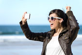Woman taking photo with phone — Stock Photo