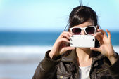 Woman taking photo — Foto Stock