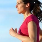Woman running portrait — Stock Photo