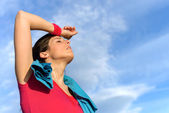Tired fitness woman sweating — Stock Photo
