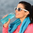Fitness woman drinking after sport training — Stock Photo