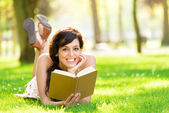 Romantic woman reading book in summer — Stock Photo