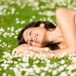 Happy woman relaxing on nature — Stock Photo