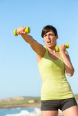 Fitness woman punching and training — Stock Photo