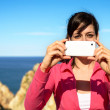 Woman taking photo with cellphone on summer — Stock Photo