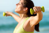 Fitness exercising with dumbbells concept — Stock Photo