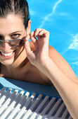 Happy woman on summer in pool — Stock Photo