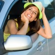 Happy woman in car daydreaming — Stock Photo #26769619
