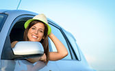 Woman in car smiling — Stock Photo