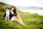 Woman vacation with dog — Stock Photo