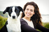 Dog and woman travel portrait — Stock Photo