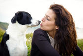 Dog and woman kiss — Stock Photo
