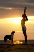 Woman and dog success and sport — Stock Photo