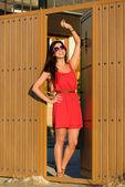 Woman opening door and welcoming — Stock Photo