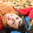 Happy joyful woman on autumn park — Stock Photo
