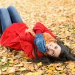 Joyful happy woman on autumn — Stock Photo