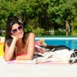 Woman and dog on summer at swimming pool — Stock Photo