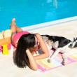 Woman and dog at swimming pool — Stock Photo