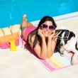 Woman and dog on summer holidays — Stock Photo