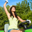 Successful gardener riding garden tractor — Stock Photo